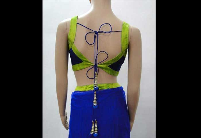 eedc1e68bfe46f This blue and green amalgamation of silky blouse back neck design that  features with awesome embroidery artwork and its closure design and a  modish open ...