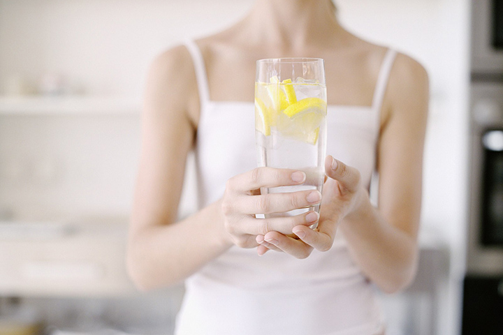 Consume a Glass of Warm Lemon Water