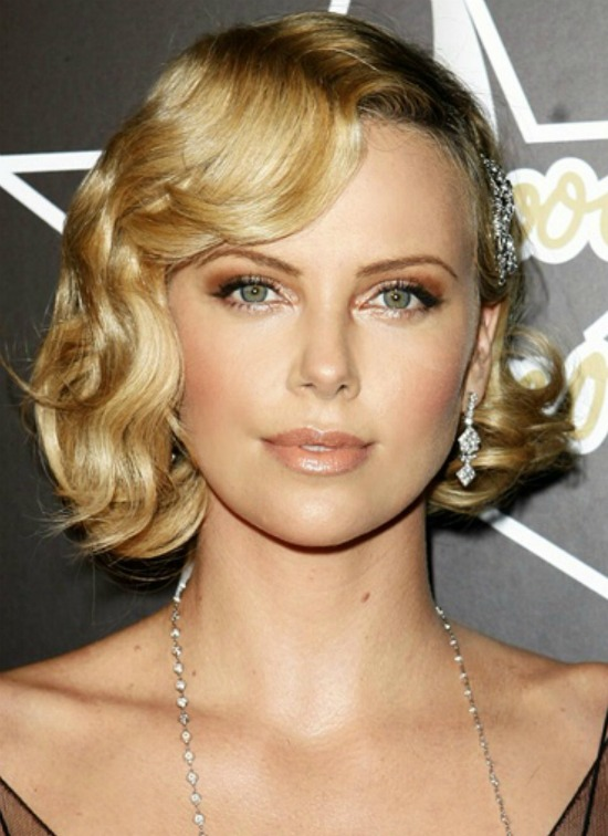 Charlize Theron deep side part and soft waves