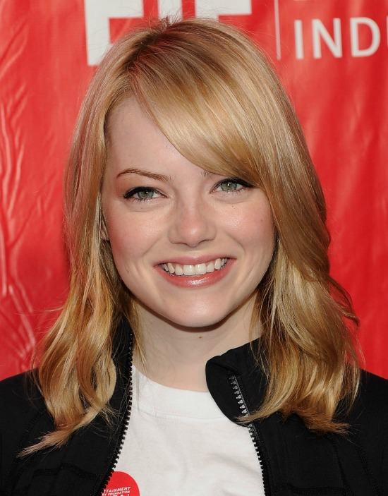 Emma Stone Medium Layered Hairstyle with Front Bangs