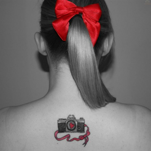 Camera Tattoo on Back Neck