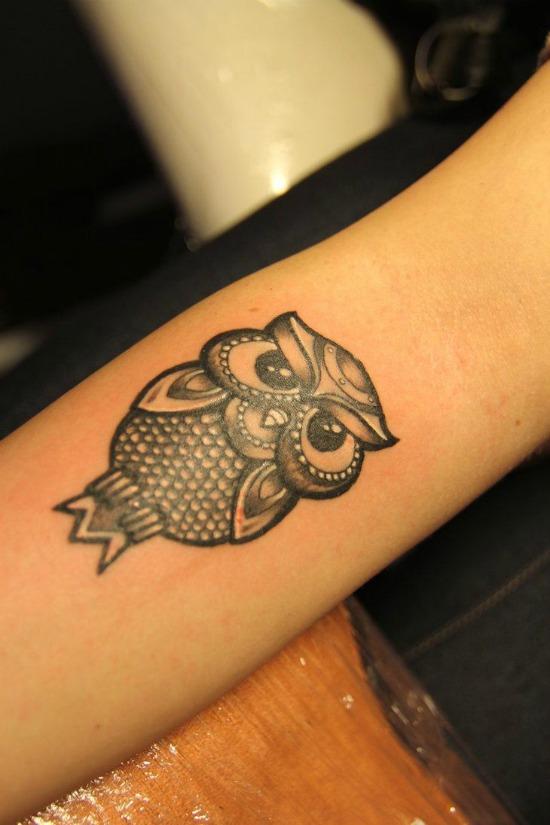 owl tattoo on arm
