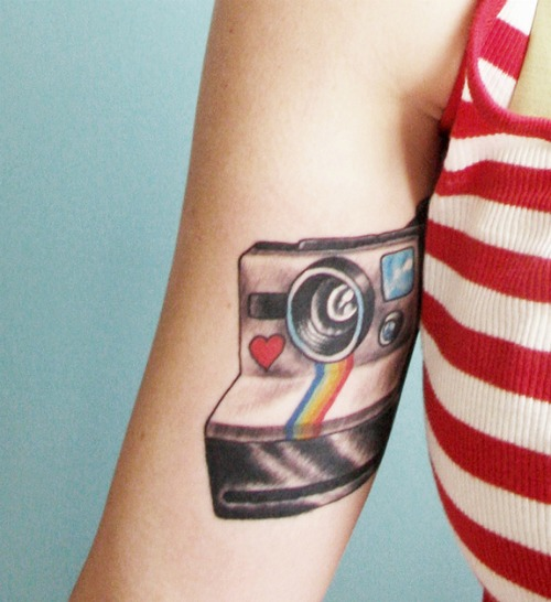 Colored Camera Tattoo on Arm