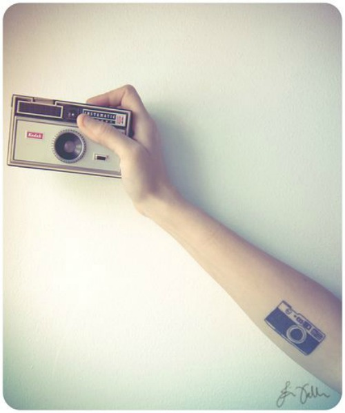 Camera Tattoo on Forehand