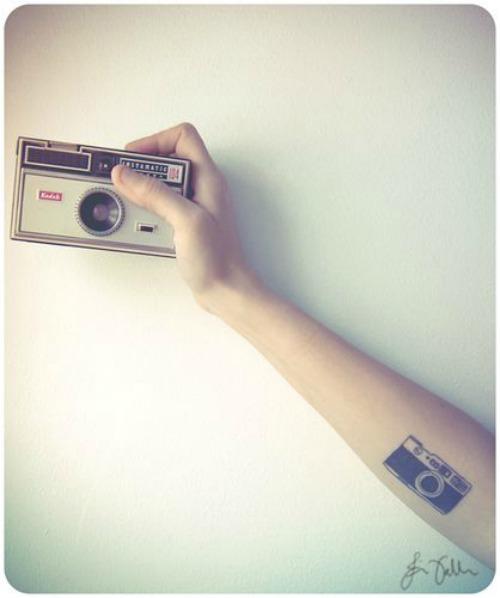 Camera Tattoo on Forehand