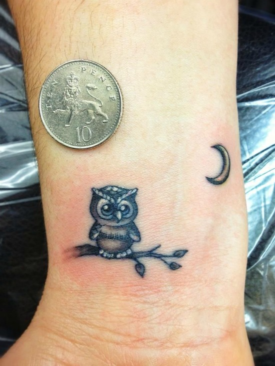 small owl tattoo on wrist
