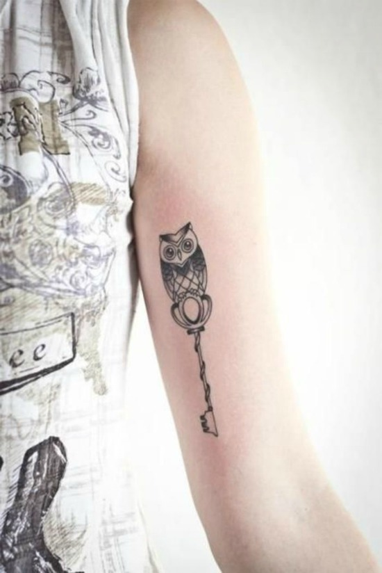 owl tattoo on inner arm
