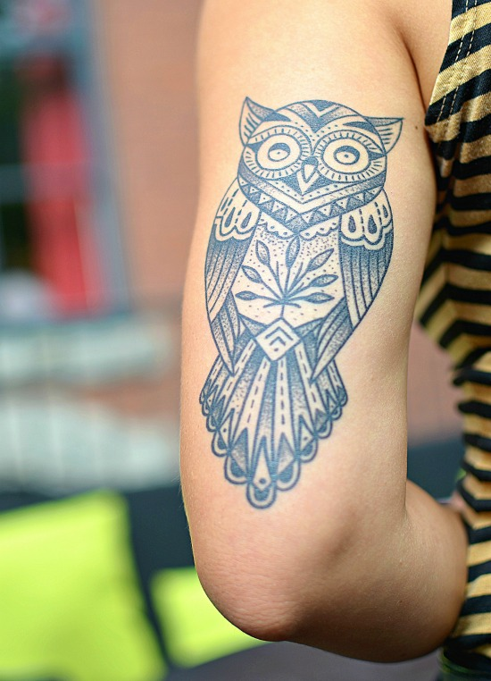 owl tattoo on back of arm