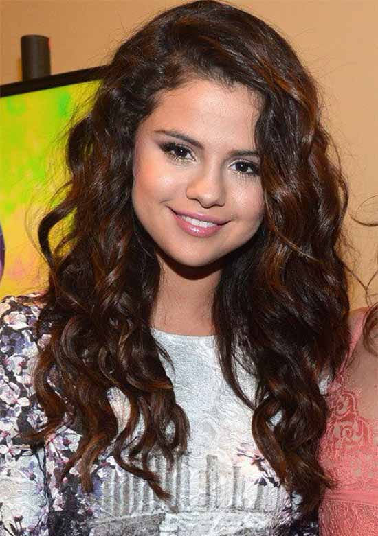 Selena Gomez curly hair with bangs