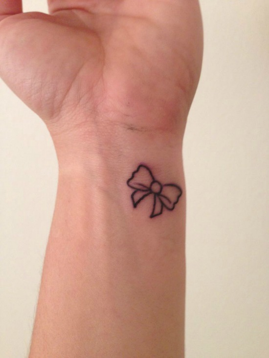 bow tattoo on wrist