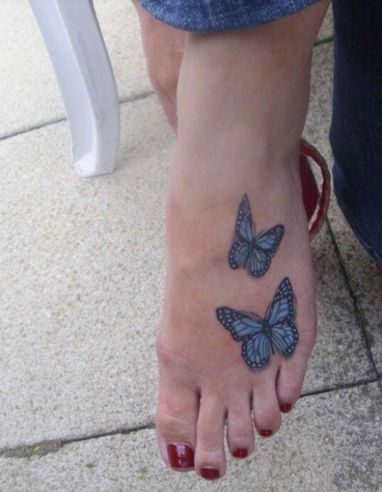 Blue butterflies foot tattoo