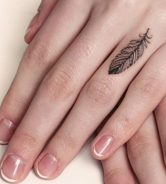 Small Feather Tattoo on Finger