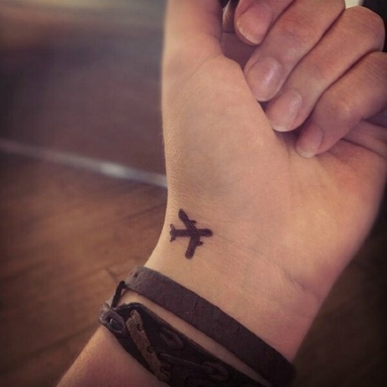 Small Plane Tattoo on Wrist