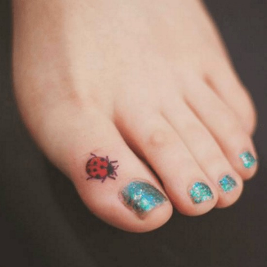 Small ladybug tattoo on toe