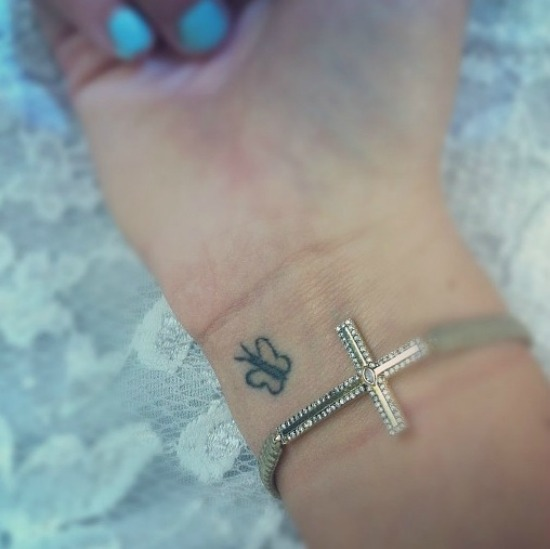 Tiny Butterfly tattoos on wrist