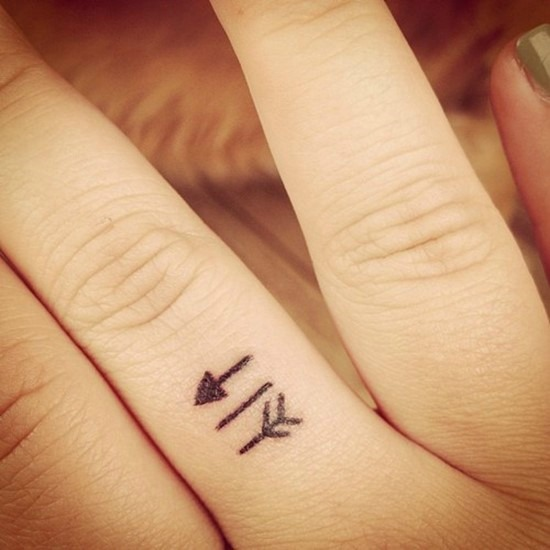 arrow small finger tattoo