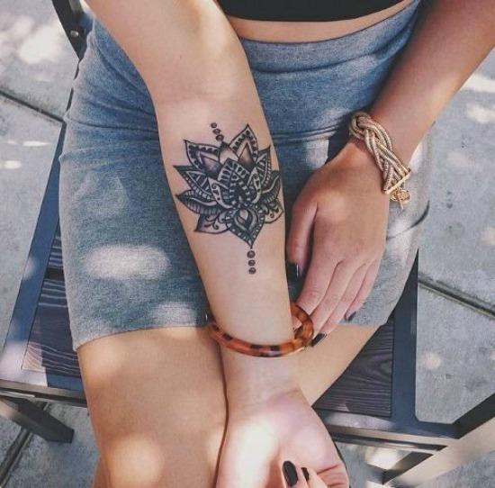 mandala flower tattoo on Arm