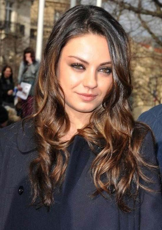 mila kunis sported long tousled curls