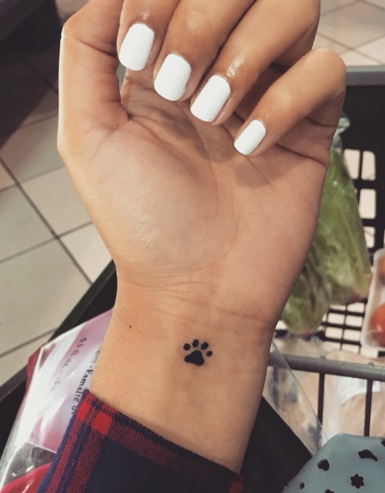 small cat paw print tattoo