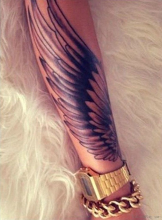 wings tattoo on arm