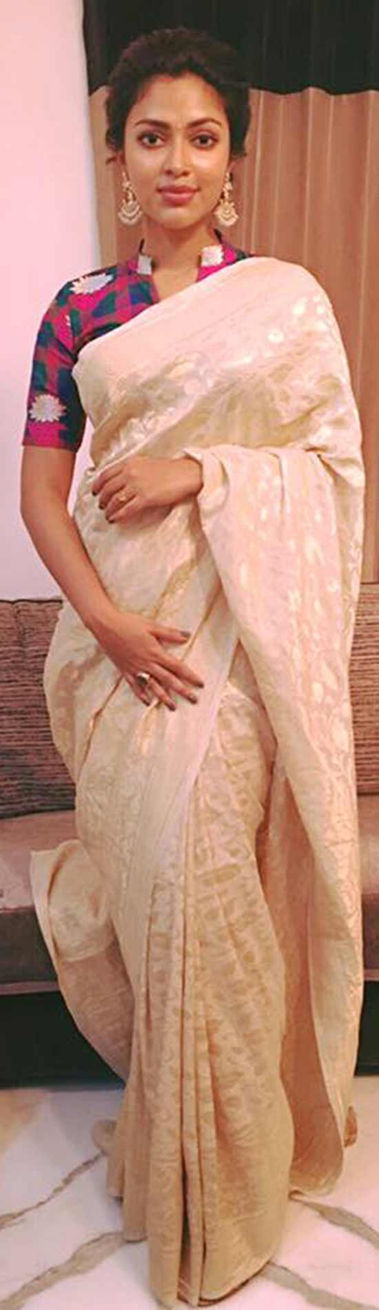 Amala Paul In a pearl white banaras saree with checked multi colored blouse