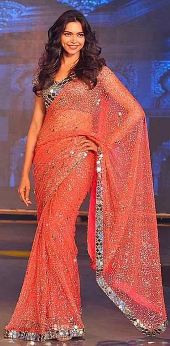 Deepika-Padukone-In-orange-mirror-work-saree-by-Manish-Malhotra