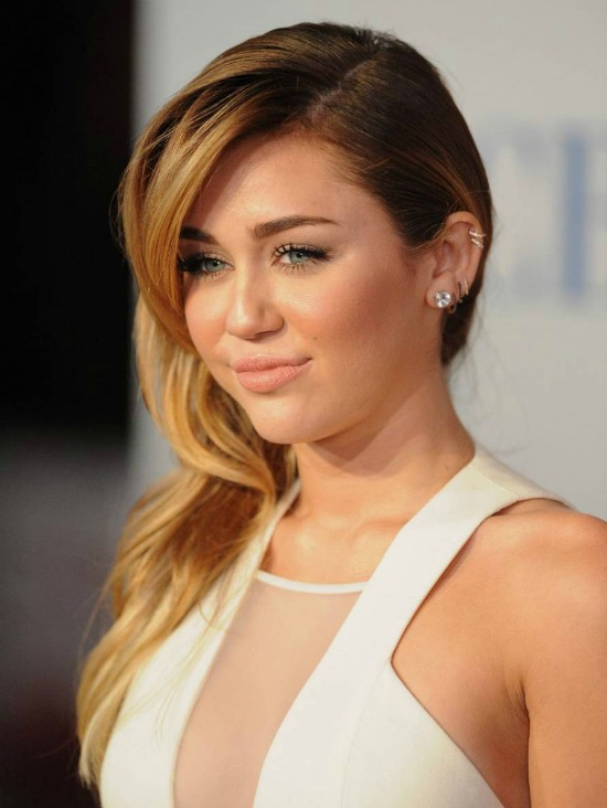 Miley Cyrus Long Side Parted Layered Hairstyle