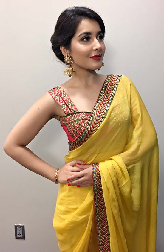 Rashi-Khanna-In-Yellow-Saree-Paired-With-Sleeveless-Blouse