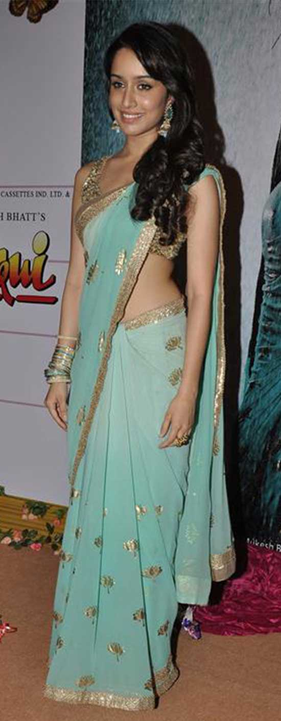 Shraddha Kapoor in an aqua blue saree paired with a sequin blouse