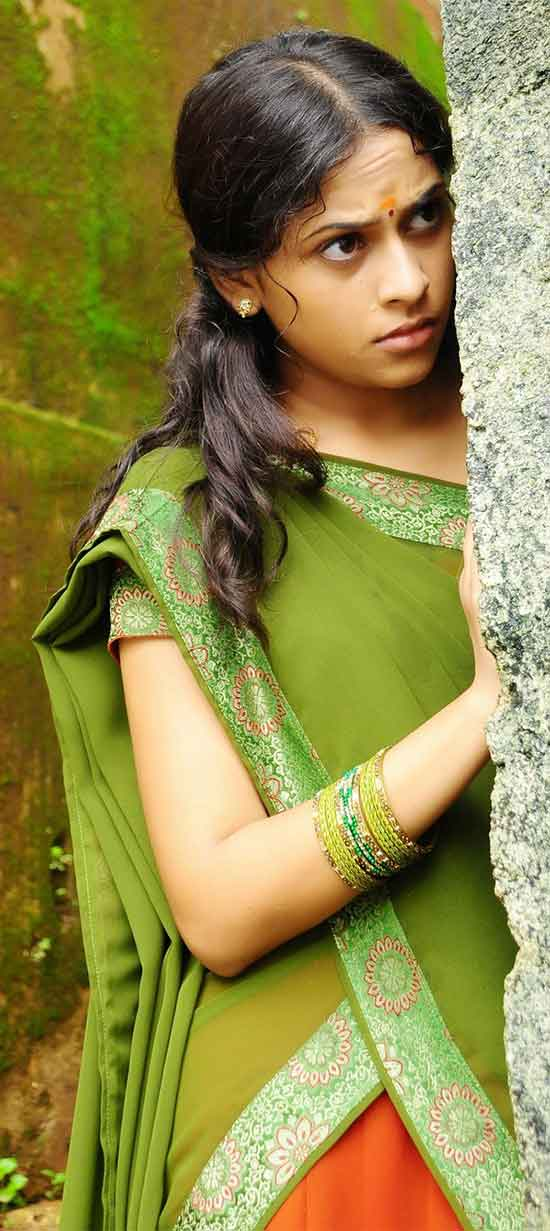 Sri-Divya-In-Green-And-Orange-Half-Saree