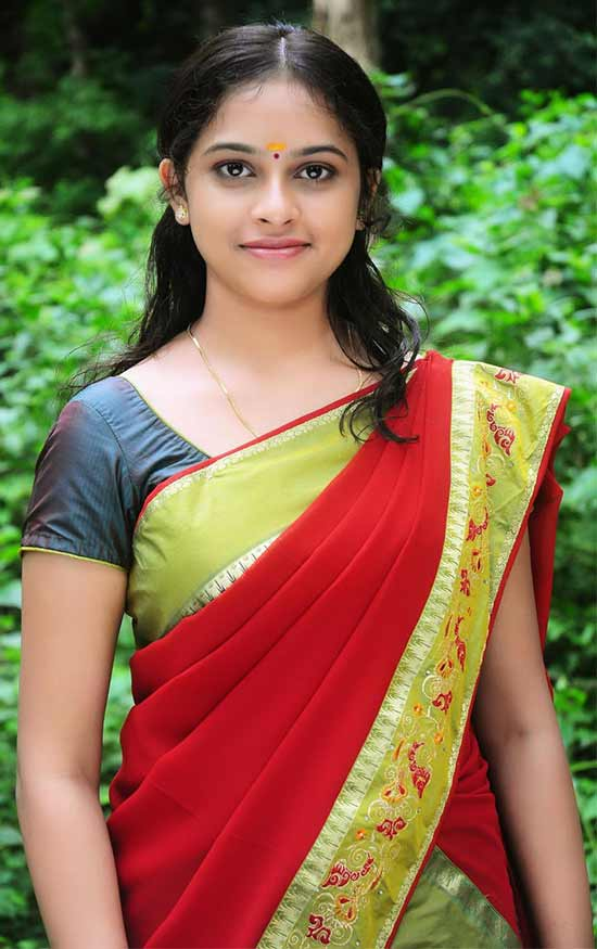 Sri-Divya-In-Maroon-And-Green-Half-Saree