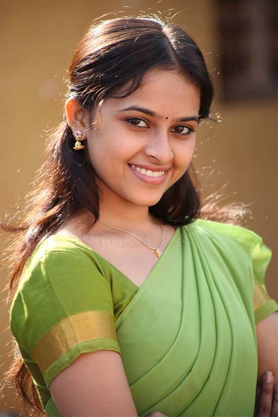 Sri-Divya-In-Parrot-Green-Half-Saree