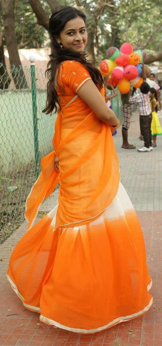 Sri-Divya-In-White-And-Orange-Half-Saree