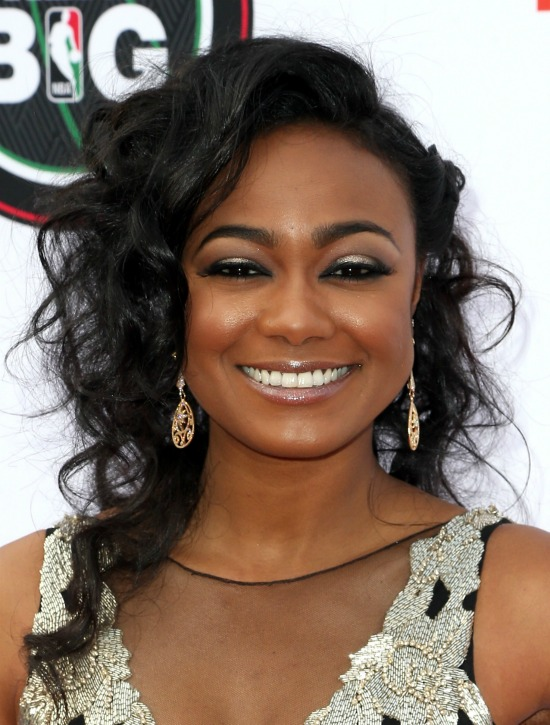 Tatyana Ali Side Parted Medium Curly Hairstyle