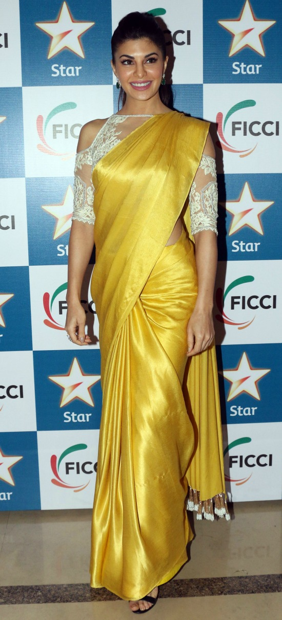 Jacqueline Fernandez In Yellow Saree With Cold Shoulder Blouse