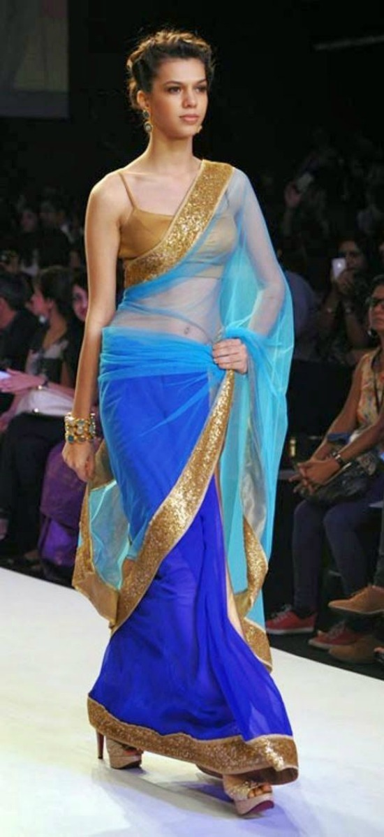 Blue transparent saree with golden borders and golden blouse
