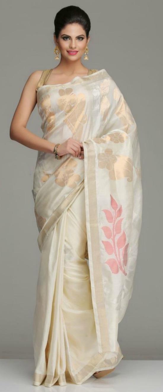 Ivory Uppada Silk Saree With Bold Dull Gold Silver Zari Floral Motifs And Peacock Motifs