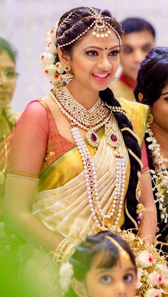 Bride in White saree with smile