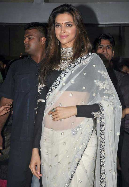 Deepika Padukone In White Net Saree With Floral Print Full Sleeve Blouse