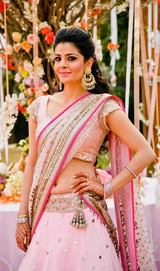 Indian bride wearing pink bridal half saree