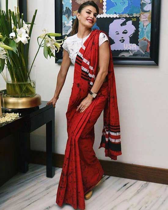 Jacqueline Fernandez In Red Saree With White T-Shirt Blouse