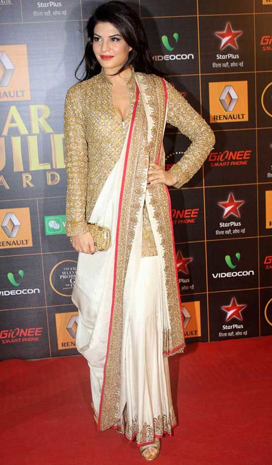 Jacqueline Fernandez In White and Gold Saree Wit a long golden blouse
