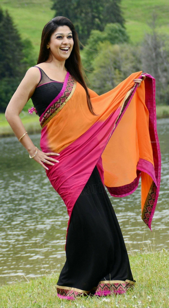 Nayantara In Black And Orange Half And Half Saree