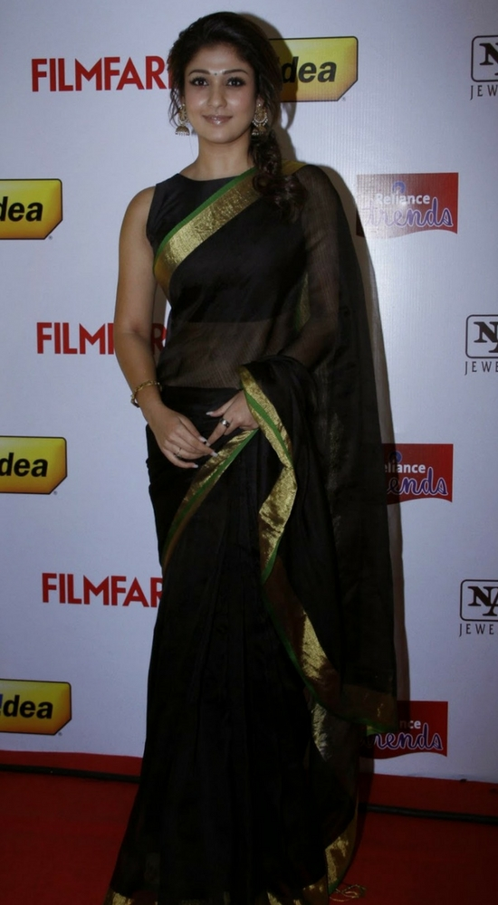 Nayantara In Black Saree Paired With Boat Neck Blouse And Gold Zari Border