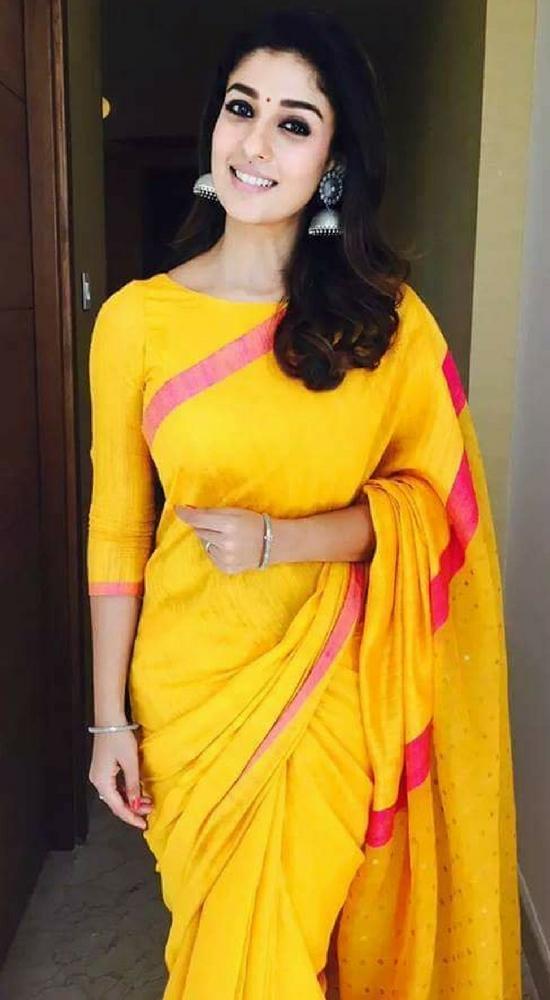 Nayantara In Yellow Saree With Quarter Sleeve Blouse