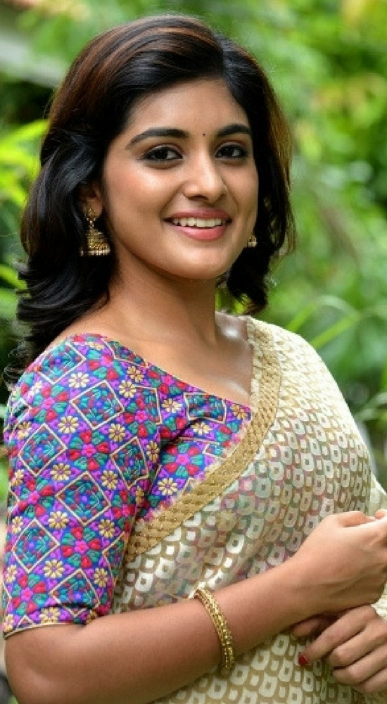 Niveda Thomas In Cream Transparent Saree