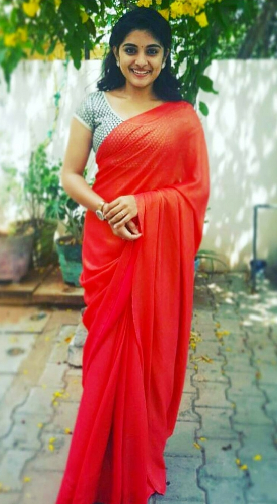 Niveda Thomas In Plain Red Saree