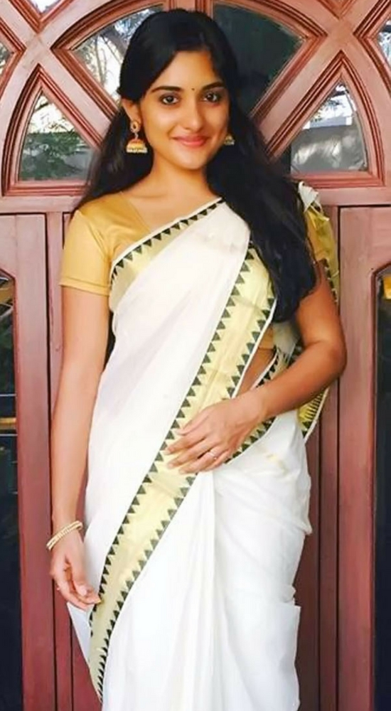 Niveda Thomas In White Saree With Zari Border