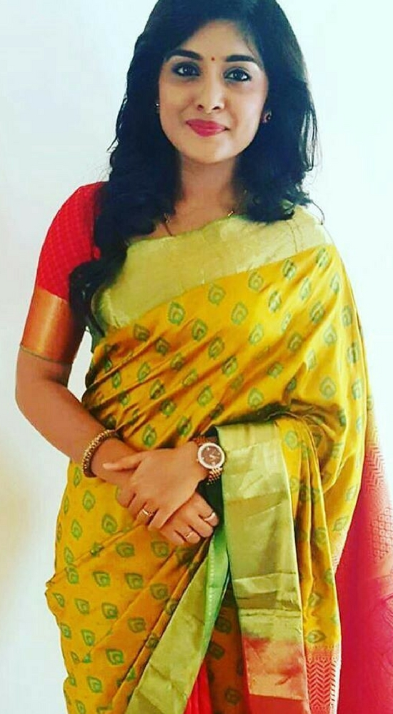 Niveda Thomas In Yellow And Green Pattu Saree