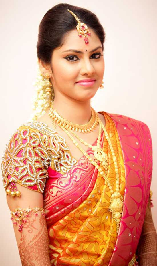 Yellow saree with elegant cut work pink blouse